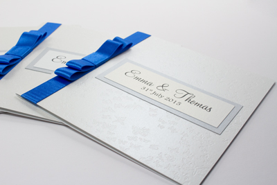 Dark royal blue, silver and white butterfly classic evening wedding invitations with flat bow