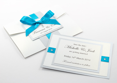 Cool blue, silver and white wedding invitations and save the date cards with Swarovski crystals