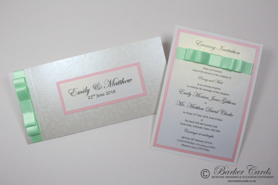Blush pink and mint green wedding invitations with butterflies