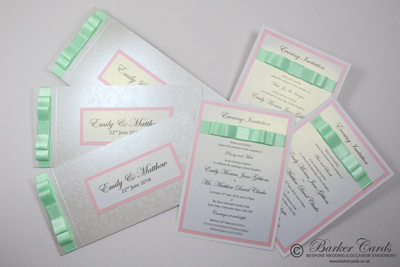 Baby pink and mint green handmade wedding invitations with butterfly theme