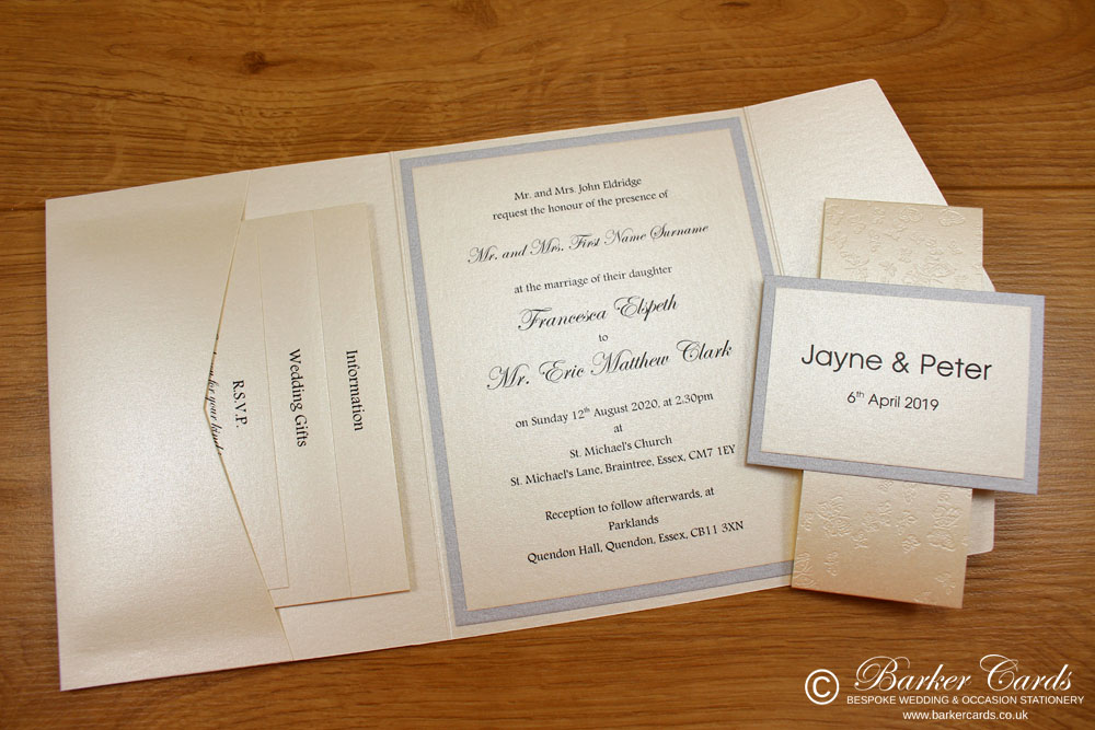 contemporary_pocketfold_wedding_invitations_in_ivory_cream_and_silver_with_band_and_ribbon_02