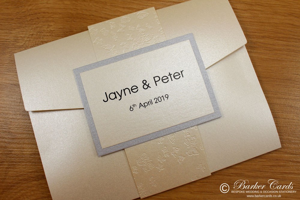 contemporary_pocketfold_wedding_invitations_in_ivory_cream_and_silver_with_band_and_ribbon_04