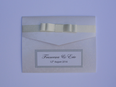 Pocketfold wedding invitation free sample made from butterfly embossed and silver card with a yellow ribbon.